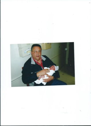 Dad holding Julian in hospital