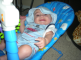 julian in baby blue with that gorgeous smile in his itsy bitsy spider bouncer chair.houston.tx