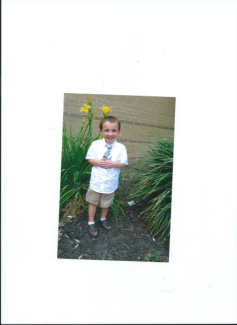 Julian in front of Easter Lillies at Prince of Peace Church in Houston though we lived in Pearland