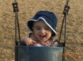 Julian swinging in Bear Creek Soccer Park with Mommy