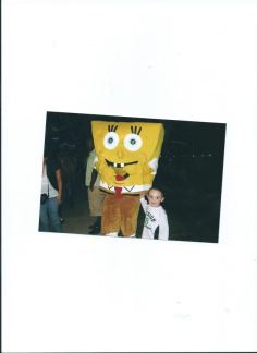 Julian with Sponge Bob Square Pants at Galveston.Moody Garden's Festival of Lights with Mommy.2011.Nov.